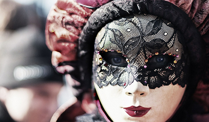 a woman wearing a mask at Carnevale