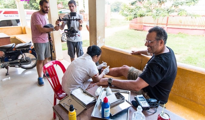 Ric from Global Gaz getting injuredin rural Cambodia getting stiches from rally accident