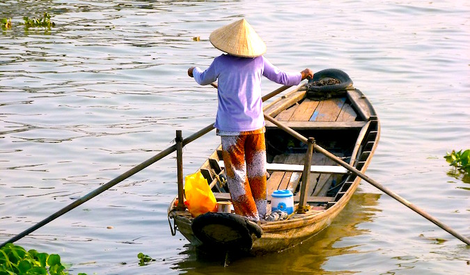 woman on a fishing boat in Southeast Asia