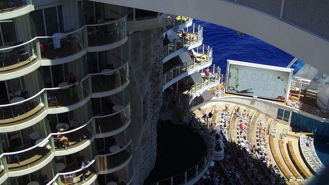 The side of a cruise ship, showing the levels of rooms and the deck