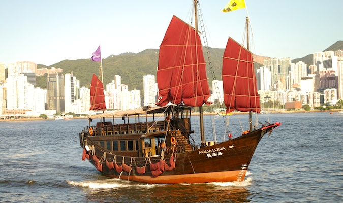 Large junk boat with big red sails in Hong Kong