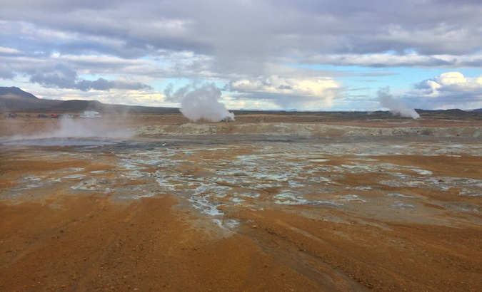 sulfur pool called Hverir with blue water and red earth