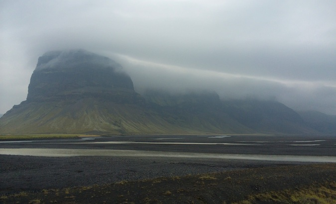on a rainy day in southern Iceland, these gigantic mountains were covered in clouds