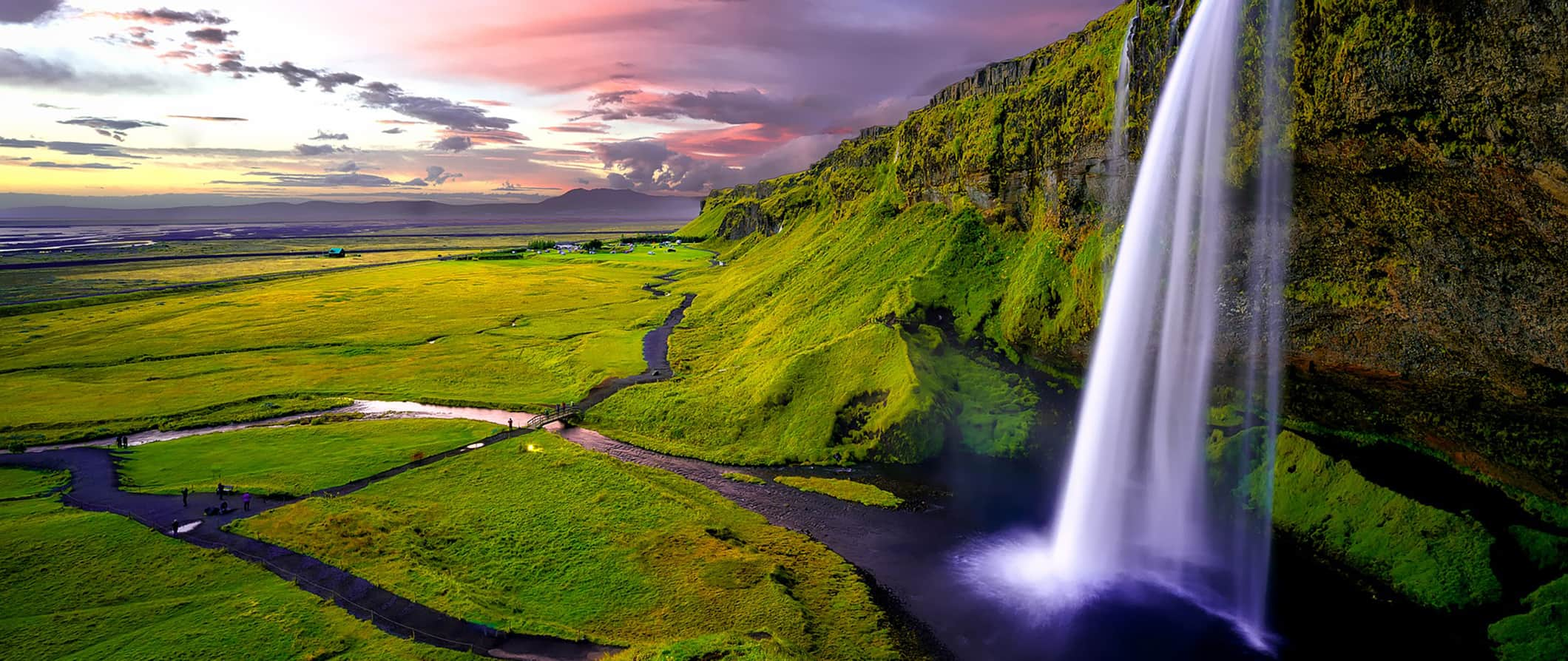 one of Iceland's many waterfalls, at sunset