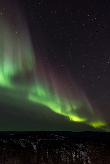 the Northern Lights flickering over Reykjavik