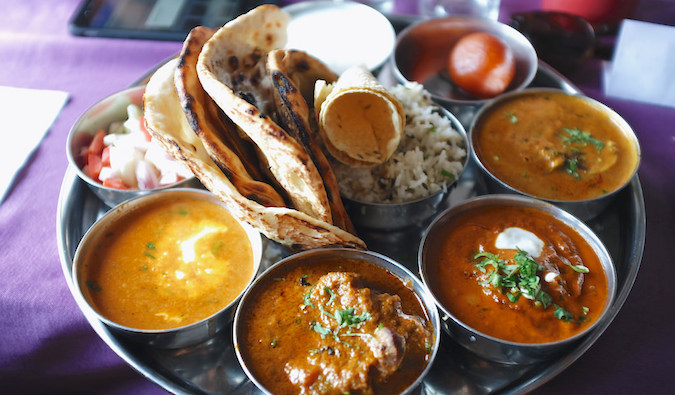 A food colorful platter of traditional thali food in India