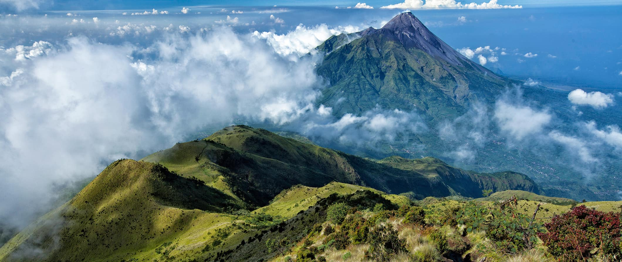 verdant mountains and volcanoes in Indonesia