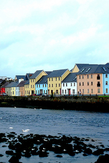 colorful buildings along the harbor in Galway, Ireland; photo by Irish Jaunt (flickr:@irishjaunt)