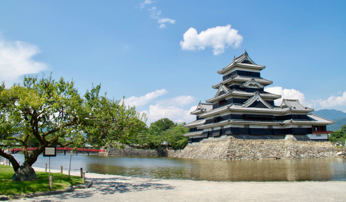 A large traditional castle in Japan on a sunny day