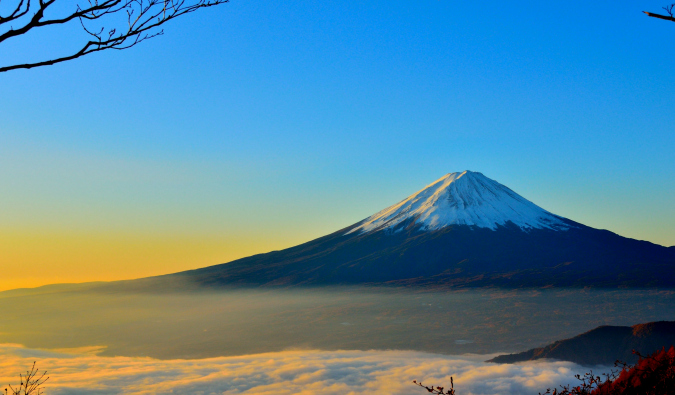The solitary and snow-capped Mount Fuji at sunrise in Japan