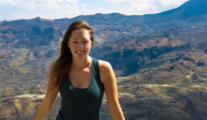 Kristen, a solo female traveler, in front of a mountain range