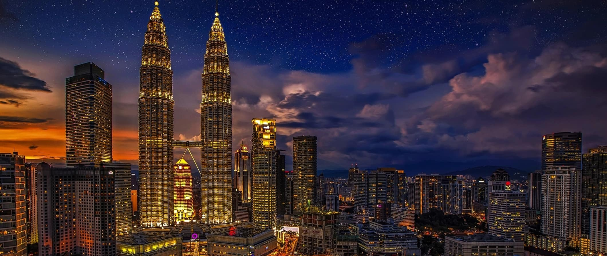 Kuala Lumpur lit up at night with the towers
