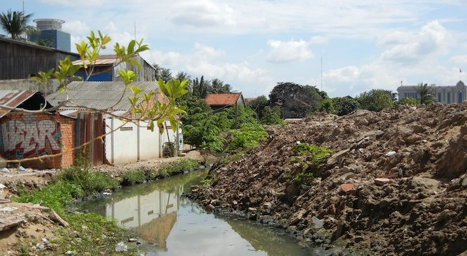 A small stream is all that is left of Beoung Kak Lake in Cambodia
