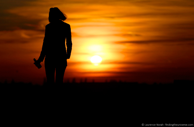 Woman walking in the sunset on vacation