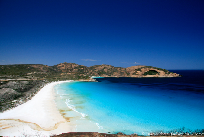 Blue skies and clear water at Hellfire Beach in Western Australia