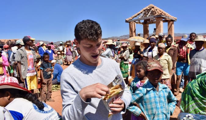 Nomadic Matt eating street food in Madagascar