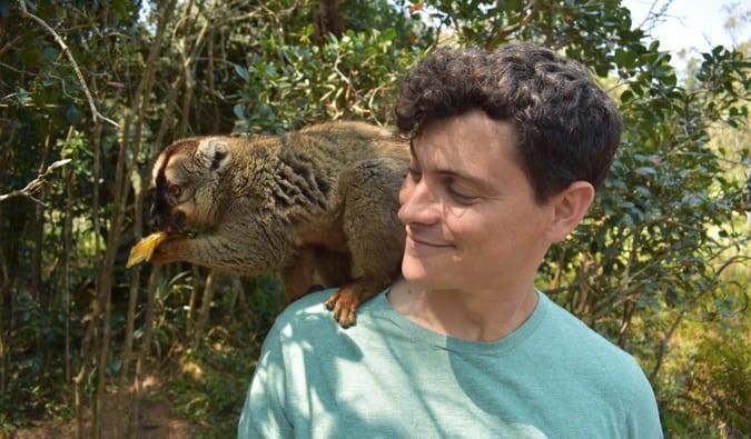 Nomadic Matt with a lemur in Madagascar