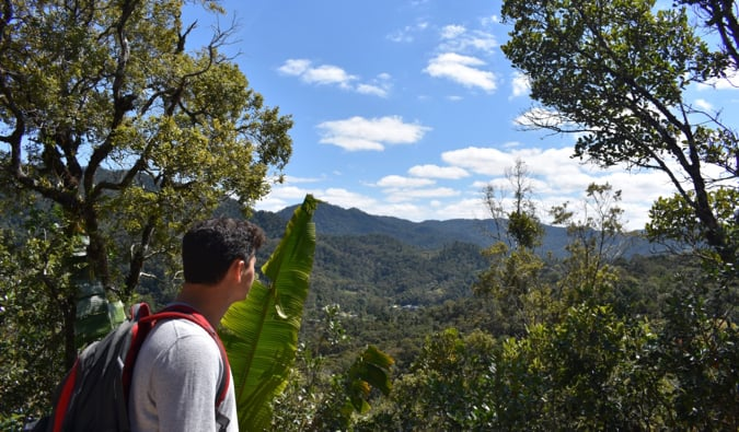 Nomadic Matt in Madagascar looking out over the mountains and forests