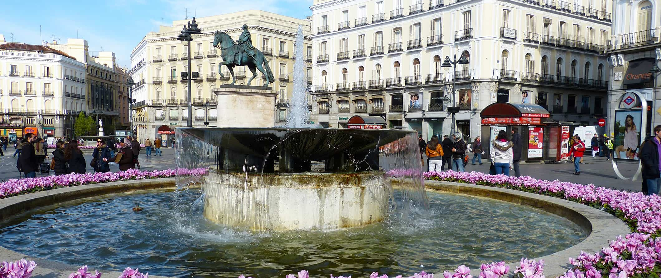people milling around a fountain in Madrid
