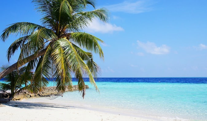 An empty beach on a sunny day in the picturesque Maldives