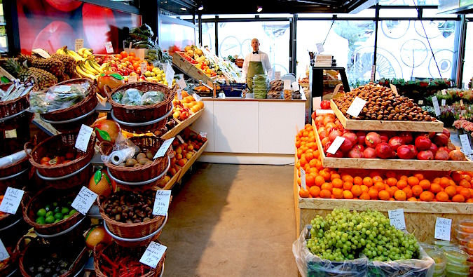 produce stacked inside a fancy supermarket