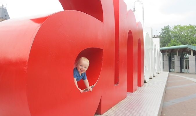 baby boy posing in the iamsterdam sign in Amsterdam, the Netherlands in Europe