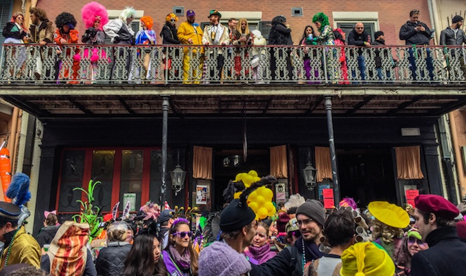 Onlookers watching the parade at Mardi Gras