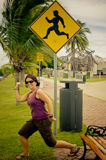 Ayngelina from Baconismagic is flexing in from of a funny street sign