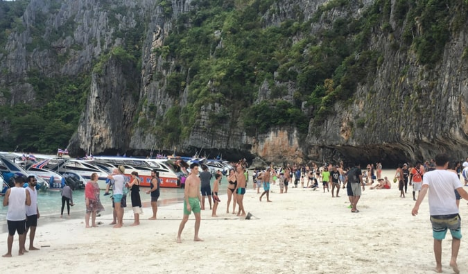a busy beach on koh phi phi