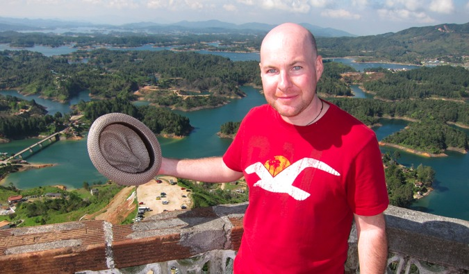 David Lee from Medellin Living standing in front of the Colombian landscape