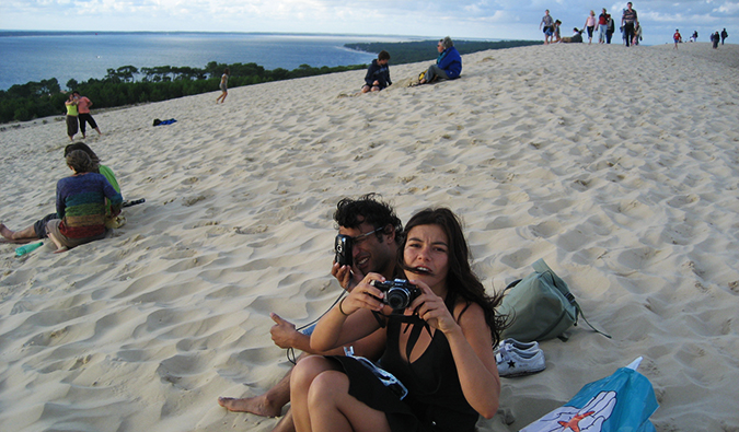 friends goofing off on a sand dune