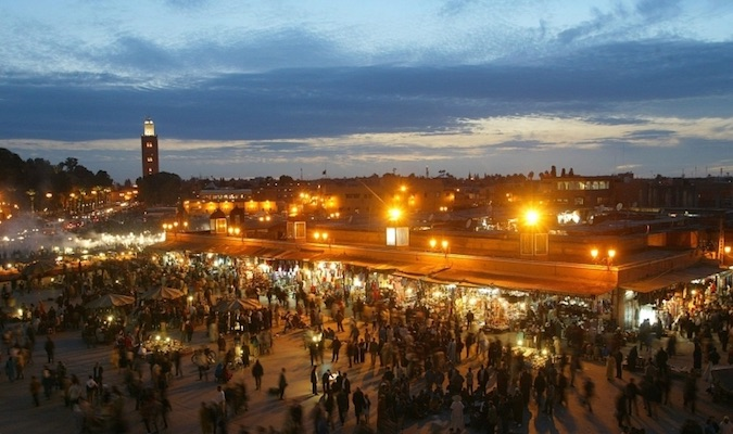 The lights and business of Marrakesh at night in Morocco