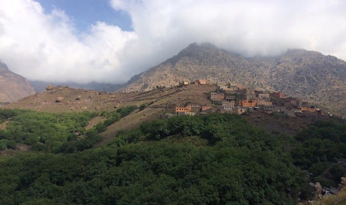 Small houses dotting the side of a mountain in Morocco