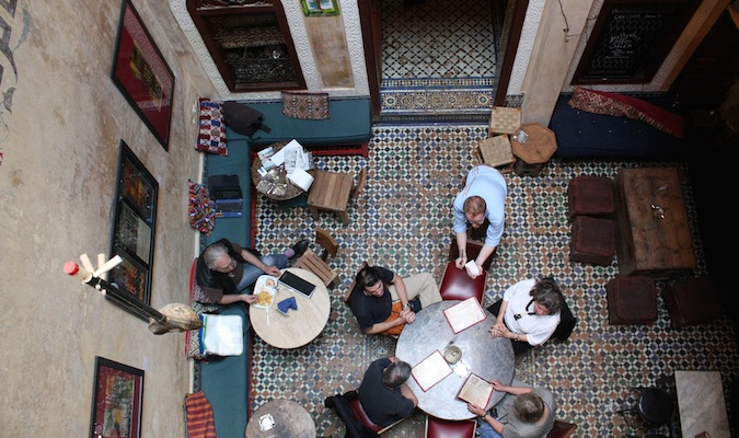 Travelers drinking tea in Cafe Clock in Fez from above