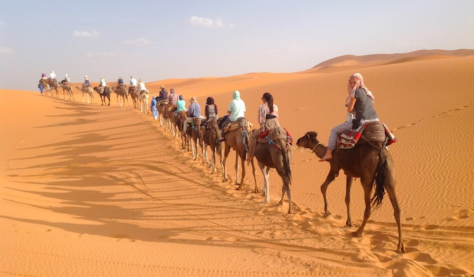 taking a camel ride through the sahara desert in morocco