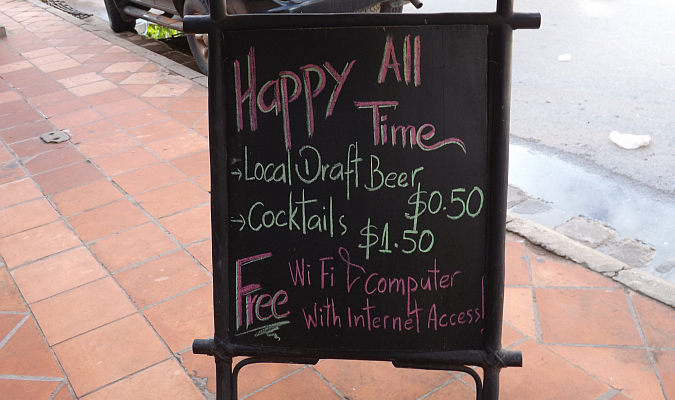 happy hour sign in cheap country to move to