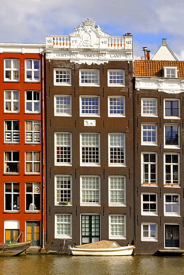 tall Dutch homes over the canal in Amsterdam