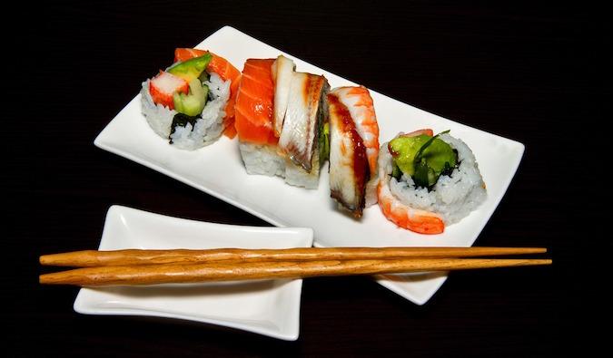 Beautiful colorful sushi and sashimi with chopsticks