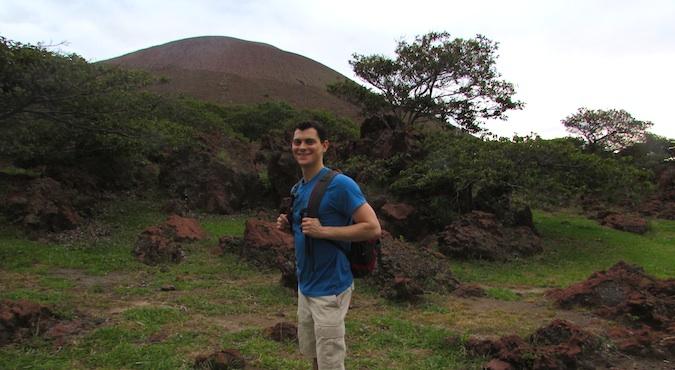Nomadic Matt hiking a volcano in Nicaragua