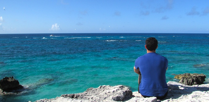 Nomadic Matt reflecting while staring at the ocean in Bermuda