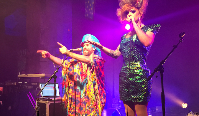 A live LGBT performance on stage at a concert venue