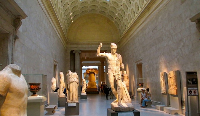 A museum hall filled ancient greek statues in New York