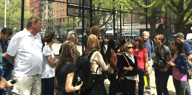A group of people on a walking tours of NYC on a sunny day