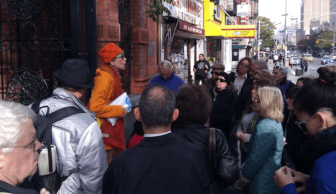 Quirky tour guide leading a group of people around Greenwich Village in NYC