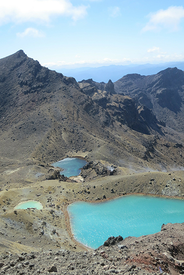 the volcanic terrain and sulfur lakes of the Tongariro Alpine Crossing