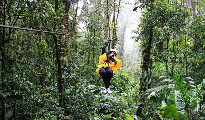 solo female minority traveler in southeast asia in a field exploring