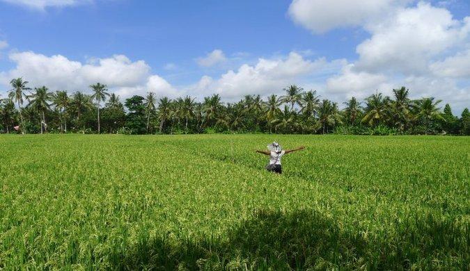 solo female minority traveler in southeast asia in a feild exploring