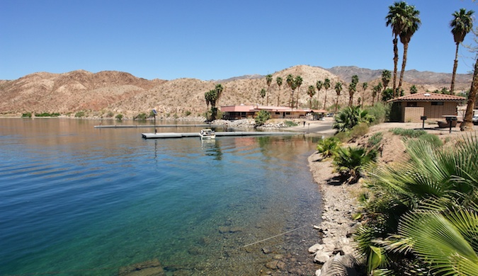 Lake Mead's clear waters, long piers and palm trees