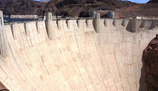 A front view of the gigantic Hoover Dam on a gorgeous day