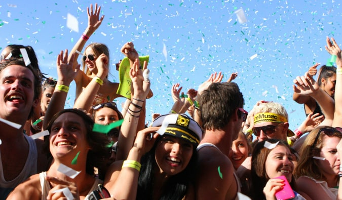 People partying with confetti at a festival in Sydney